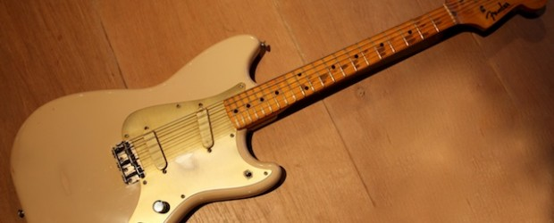 This is a vintage Fender Duosonic from 1956. Very nice Desert Sand color. It has an incredible V-shaped neck.